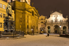 Bronze statue of the eleventh Czech King and Roman Emperor Charles IV. in night snowy Prague near Charles Bridg Stock Photo
