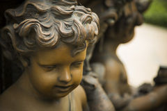 Bronze Statue of the face of a curly haired child Stock Photos