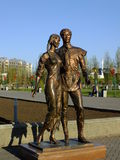 A bronze statue featuring a young couple in Astana Stock Photos