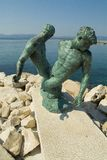 Bronze statue of fishermen dragging out the net Stock Photography