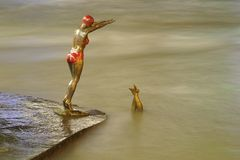 Bronze statue of girl swimmer jumping in Vardar. SKOPJE, MACEDONIA - February 23: Bronze statue of girl swimmer jumping in Vardar river at Skopje on February 23 Stock Photography