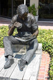 Bronze Statue in Hilton Head, S.C. Bronze statue of a young man reading a book in Harbour Town, Hilton Head, S.C Royalty Free Stock Photos