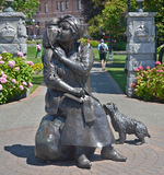 Bronze statue honors the renowned Canadian artist Emily Carr. VICTORIA BC CANADA JUNE 22 2015: Bronze statue honors the renowned Canadian artist Emily Carr Stock Photos