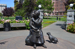 Bronze statue honors the renowned Canadian artist Emily Carr. VICTORIA BC CANADA JUNE 22 2015: Bronze statue honors the renowned Canadian artist Emily Carr Royalty Free Stock Photo