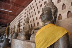 Bronze statue inside old temple,Vientiene,Laos royalty free stock images