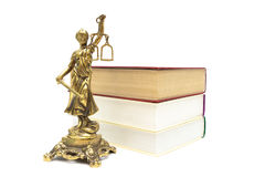 Bronze statue of justice and books on white background Royalty Free Stock Images