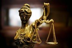 Bronze statue of justice, darker edges. Golden look antique statue of justice stock photography