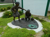Bronze Statue Of Kids In Odebolt, Iowa. Handmade bronze statues of kids at a park in Odebolt, Iowa United States Stock Images