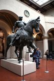 A bronze statue of a knight on horseback. Stock Photos