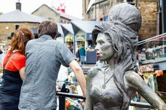 Bronze statue of late singer Amy Winehouse located at Camden Market. London, UK - July 1, 2018 - Bronze statue of late singer Amy Winehouse, by Scott Eaton stock photo