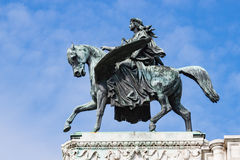 Bronze statue of man on winged horse against blue sky Stock Images