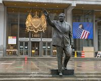 Bronze statue of Mayor Frank Rizzo in front of the Municipal Services Building, Center City, Philadelphia. Pictured is a bronze statue of Mayor Rizzo waving in stock photo