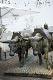 Bronze Statue of Oxen and their Driver pulling goods on wooden runners. The statue is in Funchal Madeira near the Market Hall Stock Photography