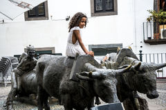 Bronze Statue of Oxen and their Driver pulling goods on wooden runners. The statue is in Funchal Madeira near the Market Hall Royalty Free Stock Images