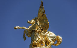 Bronze statue of Pegasus against pure blue sky Royalty Free Stock Images