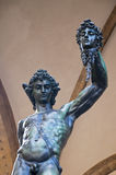 Bronze statue of Perseus holding head of Medusa Royalty Free Stock Images