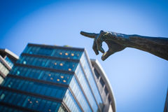 Bronze statue pointing finger Stock Images