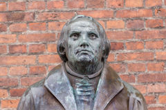 Bronze statue of the reformer Martin Luther in front of Luther c Royalty Free Stock Photography