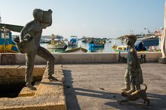 Bronze statue representing a fisherman and a boy Royalty Free Stock Images