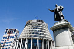 Parliament of New Zealand. The bronze statue of Richard John Seddon and the Beehive building - Parliament of New Zealand in Wellington city Royalty Free Stock Image