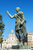 Bronze statue of the Roman emperor Trajan in Rome, Italy. Bronze statue of the Roman emperor Trajan against blue sky in Rome, Italy Royalty Free Stock Photography
