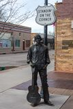 Bronze statue by Ron Adamson, forming a part of Standin` On The Corner Park in Winslow, AZ. Winslow, Arizona, United States of America - January 4, 2017. Bronze stock photo
