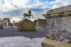 Bronze statue at ruins of Pompeii Archaeological Park in Pompeii stock photography