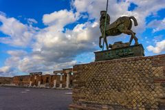 Bronze statue at ruins of roman town Pompeii royalty free stock images
