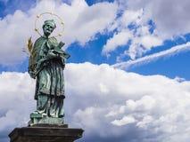 Bronze statue of Saint John of Nepomuk, Charles Bridge, Prague, Czech Republic Stock Image