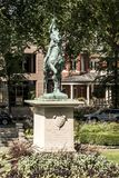 Bronze statue Sancta Joanna D arc - Joan of Arc war memorial in a colorful garden on a sunny day Stock Photo