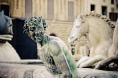 Bronze statue of a satyr,Neptune Fountain detail. Bronze statue of a satyr, detail of Neptune Fountain in Florence, situated on the Piazza della Signoria Royalty Free Stock Photography