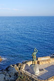 Bronze statue and sea. Royalty Free Stock Photography