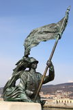 Bronze statue of a soldier. With flag Royalty Free Stock Image