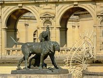 Statue of hunting dogs, detail of the Castle of chantilly, france. Bronze statue of two hunting dogs, detail of castle of chantilly, france, neo-classical royalty free stock photo