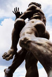 Bronze statue of two wrestlers stock photography
