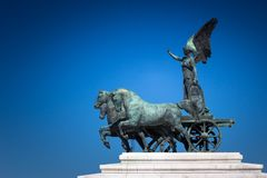Bronze statue of Winged Victory on the top of King Vittorio Emanuele II monument, also know as Vittoriano royalty free stock photo