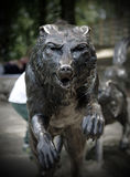 Bronze statue of a wolf head. Bronze wolf head that growls and shows teeth stock photo