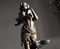 BRONZE STATUE OF A WOMAN WITH BIRDS. Female holding birds sculpture low angle Royalty Free Stock Photos