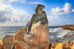 Bronze statue of woman called `Sol Alter` on a stone, Paphos, Cy stock photo
