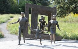 Bronze Statues of Men, Women and Children Stock Images