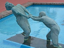 Bronze statues. MYRTLE BEACH SOUTH CAROLINA JUNE 29 2016: Bronze statues dedicated to the families of the world sponsored by Burroughs & Chapin Company Inc Royalty Free Stock Image