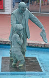 Bronze statues. MYRTLE BEACH SOUTH CAROLINA JUNE 29 2016: Bronze statues dedicated to the families of the world sponsored by Burroughs & Chapin Company Inc Royalty Free Stock Images