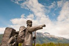 Bronze statues progressing forward Stock Photo