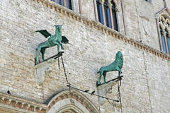 Bronze statues of a winged Griffin and a lion in Perugia. Bronze statues of a winged Griffin and a lion in the Centre of Perugia stock photos