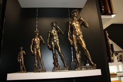 Bronze statuettes of David by Michelangelo arranged in a row royalty free stock image