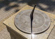 Bronze sundial with roman numerals, shadow and glam Royalty Free Stock Photo