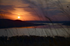 Bronze Sunrise. Sun rising over the dunes Royalty Free Stock Photo