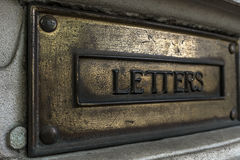 Bronze tablet. Bronze tablet saying `letters`on a wall Stock Image