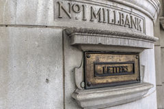 Bronze tablet. Bronze tablet saying `letters`on a wall of Millbank Stock Photos