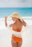 Bronze Tan Woman Sunbathing At Tropical Beach Royalty Free Stock Photo